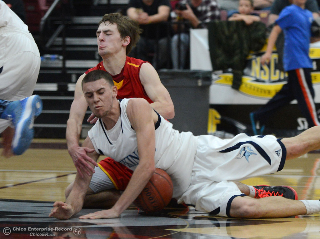 Description of . Chico High's #12 Sterling Winter (left) reaches for a loose ball against Pleasant Valley High's #4 Jerry Migasi (right) in the fourth quarter of their boys basketball game at Acker Gym Saturday, March 8, 2014 in Chico, Calif.  (Jason Halley - Enterprise-Record)