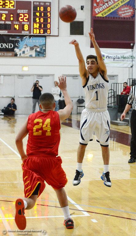 Description of . Pleasant Valley High's #1 Joseph Abdulmasih (right) takes a shot against Chico High's #24 Angel Roldan (left) in the second quarter of their boys basketball game at Acker Gym Saturday, March 8, 2014 in Chico, Calif.  (Jason Halley - Enterprise-Record)