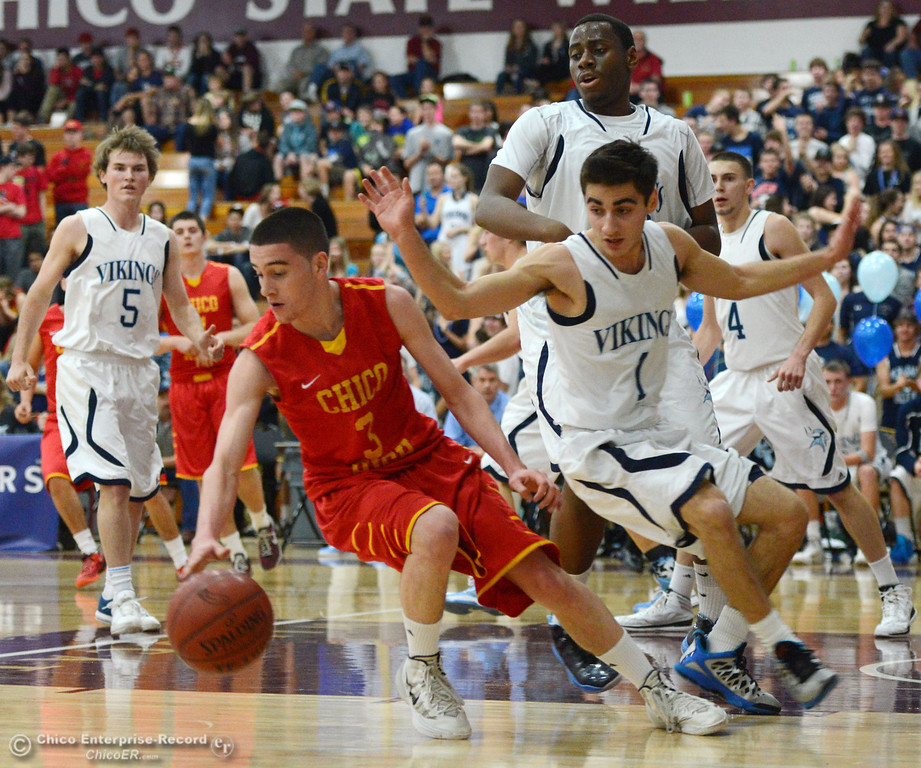 Description of . Chico High's #3 Myles Lawing (left) dribbles against Pleasant Valley High's #1 Joseph Abdulmasih (right) in the first quarter of their boys basketball game at Acker Gym Saturday, March 8, 2014 in Chico, Calif.  (Jason Halley - Enterprise-Record)