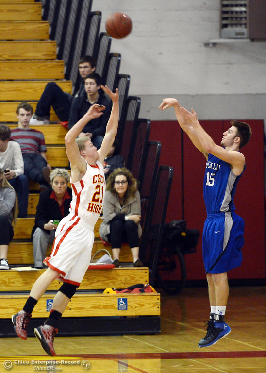 Description of . Chico High's #21 Hunter Mootz (left) attempts to block against Rocklin High's #15 Vinnie Safin (right) in the second quarter of their boys basketball game at CHS Tuesday, January 7, 2014 in Chico, Calif.  (Jason Halley/Chico Enterprise-Record)