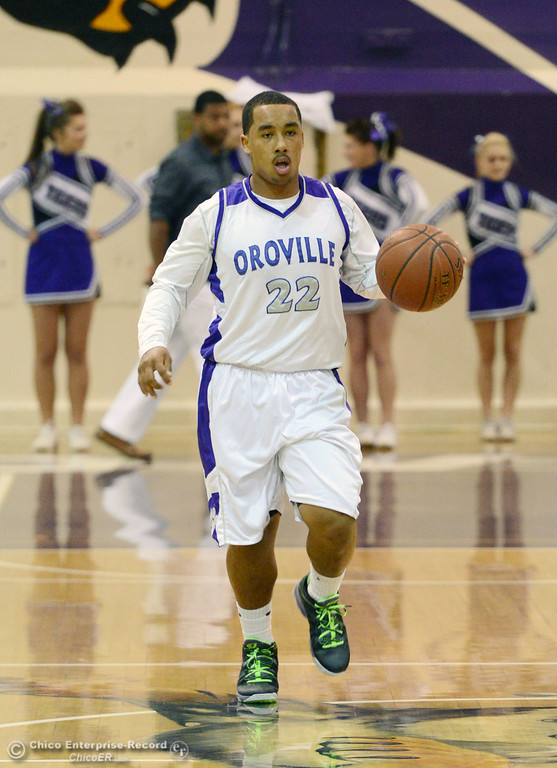 . Oroville High\'s #22 James Jones dribbles against Pleasant Valley High in the second quarter of their boys basketball game at OHS Wednesday, February 19, 2014 in Oroville, Calif.  (Jason Halley/Chico Enterprise-Record)