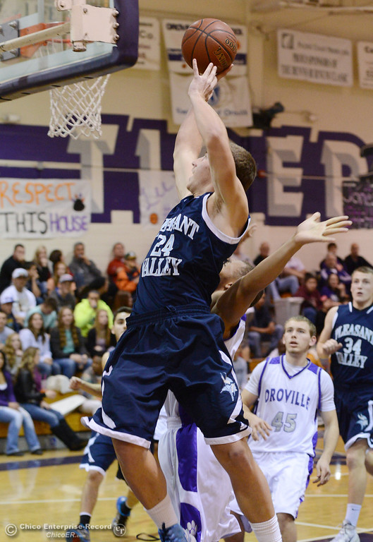 . Pleasant Valley High\'s #24 Zack Suttles goes up for a shot against Oroville High in the first quarter of their boys basketball game at OHS Wednesday, February 19, 2014 in Oroville, Calif.  (Jason Halley/Chico Enterprise-Record)