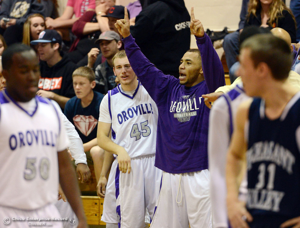 . Oroville High\'s #15 Derrek Gordon reacts to his teams big lead against Pleasant Valley High in the fourth quarter of their boys basketball game at OHS Wednesday, February 19, 2014 in Oroville, Calif.  (Jason Halley/Chico Enterprise-Record)
