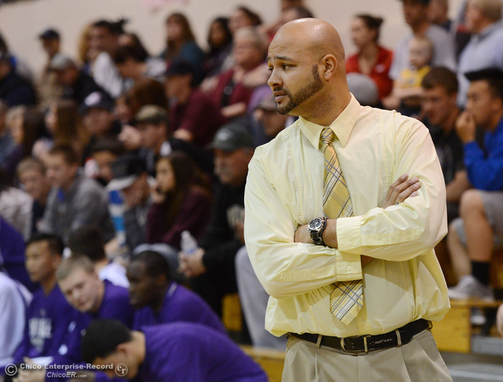 . Oroville High coach Robert Anderson looks on against Pleasant Valley High in the first quarter of their boys basketball game at OHS Wednesday, February 19, 2014 in Oroville, Calif.  (Jason Halley/Chico Enterprise-Record)
