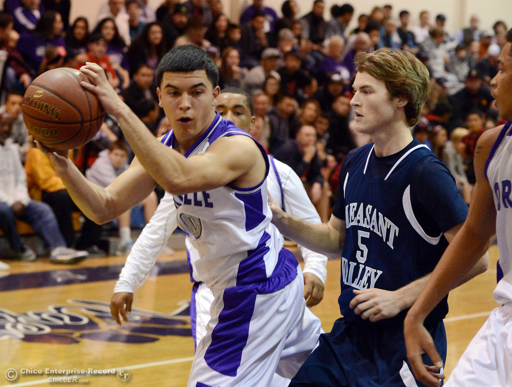 . Oroville High\'s #10 Tyler Liese (left) rebounds against Pleasant Valley High\'s #5 Tyler Collier (right) in the first quarter of their boys basketball game at OHS Wednesday, February 19, 2014 in Oroville, Calif.  (Jason Halley/Chico Enterprise-Record)
