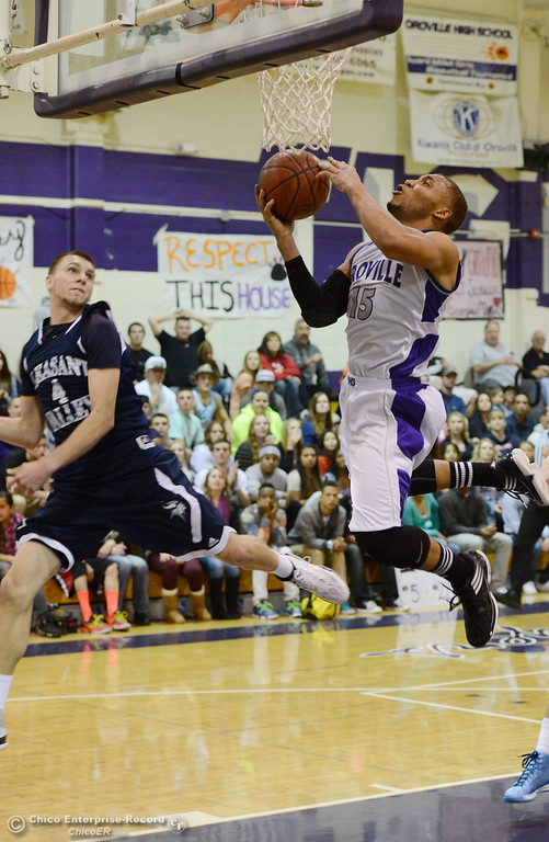 . Oroville High\'s #15 Derrek Gordon (right) goes up for a shot against Pleasant Valley High\'s #4 Jerry Migasi (left) in the fourth quarter of their boys basketball game at OHS Wednesday, February 19, 2014 in Oroville, Calif.  (Jason Halley/Chico Enterprise-Record)