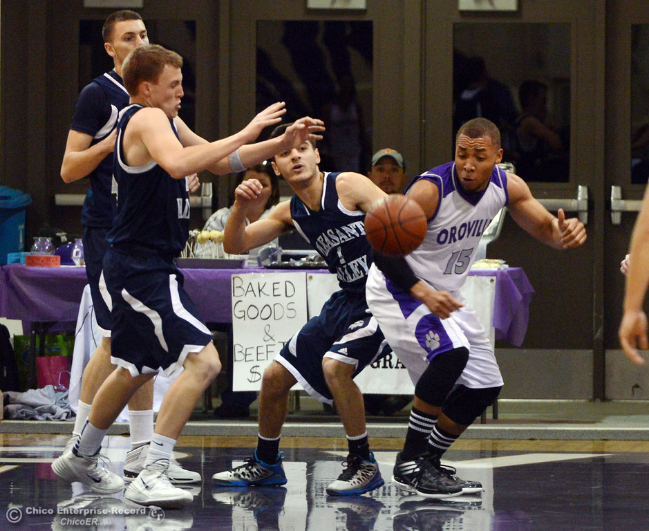 . Pleasant Valley High\'s #4 Jerry Migasi, #34 Brandt Hughes, and #1 Joseph Abdulmasih battle for a loose ball against Oroville High\'s #15 Derrek Gordon (left to right) in the first quarter of their boys basketball game at OHS Wednesday, February 19, 2014 in Oroville, Calif.  (Jason Halley/Chico Enterprise-Record)