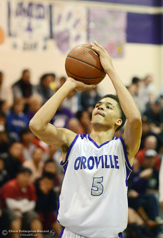 . Oroville High\'s #5 Kahliel Wyatt takes a free throw against Pleasant Valley High in the fourth quarter of their boys basketball game at OHS Wednesday, February 19, 2014 in Oroville, Calif.  (Jason Halley/Chico Enterprise-Record)