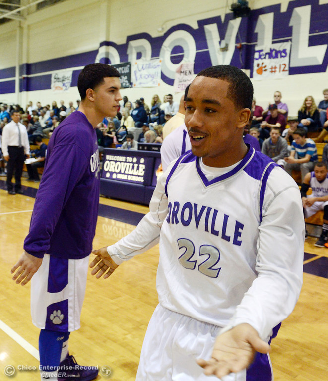 . Oroville High\'s #22 James Jones comes on to the court against Pleasant Valley High in the first quarter of their boys basketball game at OHS Wednesday, February 19, 2014 in Oroville, Calif.  (Jason Halley/Chico Enterprise-Record)