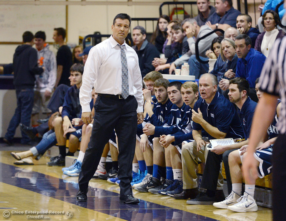 . Pleasant Valley High coach Tim Keating looks on against Oroville High in the first quarter of their boys basketball game at OHS Wednesday, February 19, 2014 in Oroville, Calif.  (Jason Halley/Chico Enterprise-Record)
