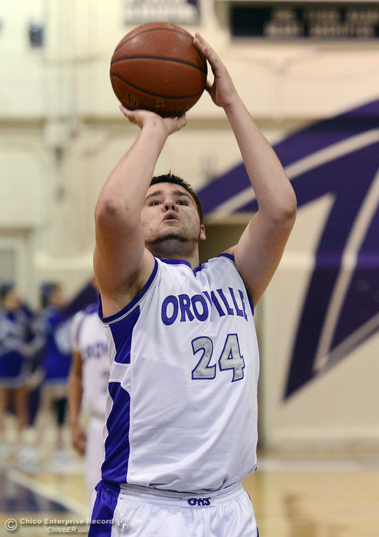 . Oroville High\'s #24 Chris White takes a free throw against Pleasant Valley High in the second quarter of their boys basketball game at OHS Wednesday, February 19, 2014 in Oroville, Calif.  (Jason Halley/Chico Enterprise-Record)