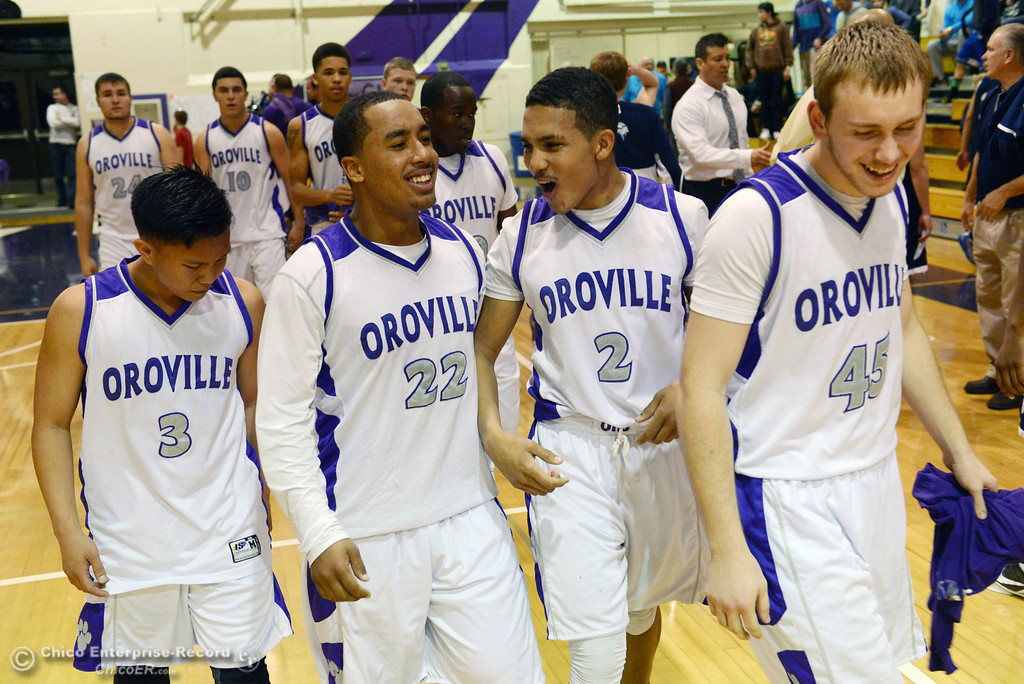 . Oroville High\'s #3 William Xiong, #22 James Jones, #2 Marcus Wilhite, and #45 Eric Laster (left to right) celebrate their win against Pleasant Valley High at the end of the fourth quarter of their boys basketball game at OHS Wednesday, February 19, 2014 in Oroville, Calif.  (Jason Halley/Chico Enterprise-Record)