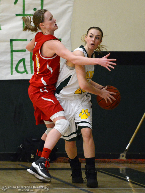 . Chico High\'s #14 Lindsey Lundberg (left) defends against Paradise High\'s #25 Larissa Knifong (right) in the first quarter of their girls basketball game at PHS Tuesday, February 18, 2014 in Paradise, Calif.  (Jason Halley/Chico Enterprise-Record)