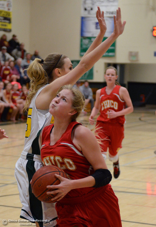 . Chico High\'s #24 Jessi MicKow (right) dribbles against Paradise High\'s #25 Larissa Knifong (left) in the first quarter of their girls basketball game at PHS Tuesday, February 18, 2014 in Paradise, Calif.  (Jason Halley/Chico Enterprise-Record)