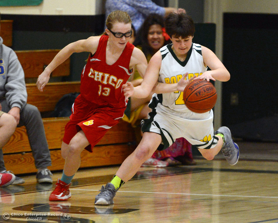 . Chico High\'s #13 Sharlotte Sheffield (left) reaches for a loose ball against Paradise High\'s #22 Ashley Holmes (right) in the first quarter of their girls basketball game at PHS Tuesday, February 18, 2014 in Paradise, Calif.  (Jason Halley/Chico Enterprise-Record)