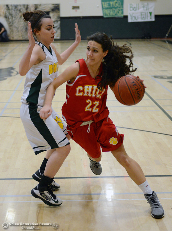 . Chico High\'s #22 Cia Seibert (right) dribbles against Paradise High\'s #10 Mary Hansen (left) in the first quarter of their girls basketball game at PHS Tuesday, February 18, 2014 in Paradise, Calif.  (Jason Halley/Chico Enterprise-Record)