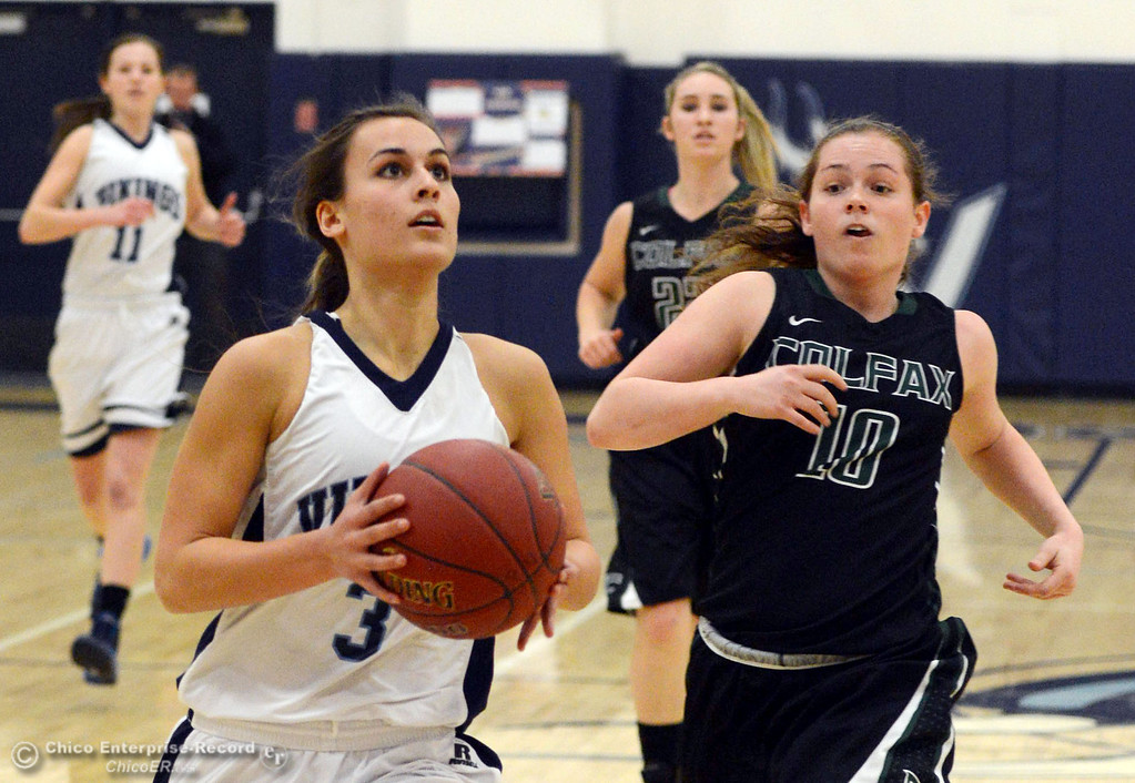 . Pleasant Valley High\'s #3 Izzy Bonacorsi (left) dribbles against Colfax High\'s #10 Taylor Avila (right) in the first quarter of their girls basketball game at PV\'s Varley Gym Saturday, December 7, 2013 in Chico, Calif. (Jason Halley/Chico Enterprise-Record)
