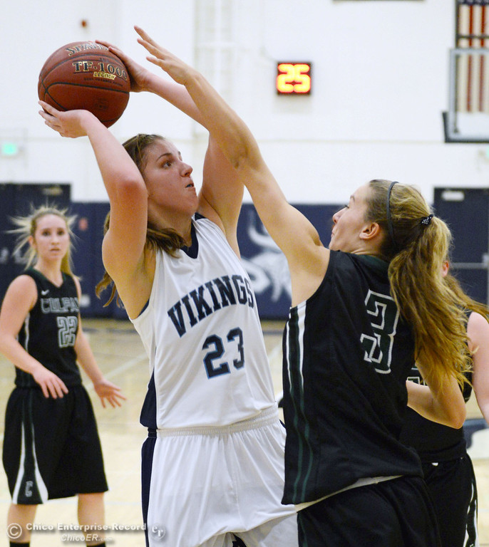 . Pleasant Valley High\'s #23 McKena Barker (left) takes a shot against Colfax High\'s #3 Kyra Heimann (right) in the second quarter of their girls basketball game at PV\'s Varley Gym Saturday, December 7, 2013 in Chico, Calif. (Jason Halley/Chico Enterprise-Record)