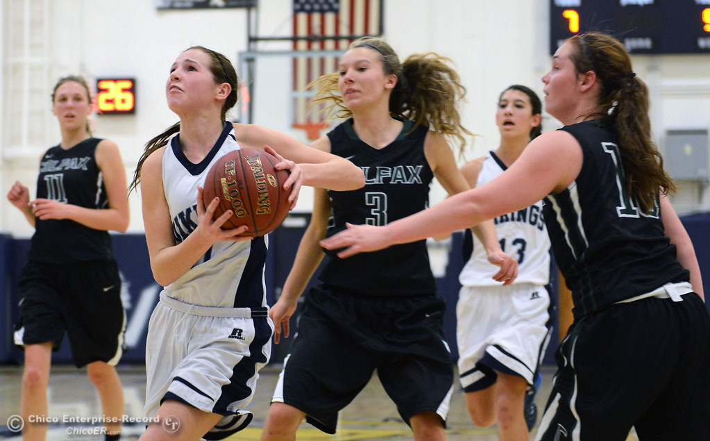 . Pleasant Valley High\'s #11 Kristina Joyce (left) drives to the basket against Colfax High\'s #3 Kyra Heimann (center) and #10 Taylor Avila (right) in the second quarter of their girls basketball game at PV\'s Varley Gym Saturday, December 7, 2013 in Chico, Calif. (Jason Halley/Chico Enterprise-Record)