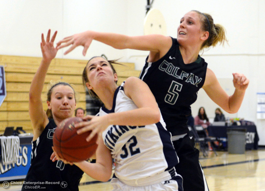 . Pleasant Valley High\'s #32 Natalie Makel (center) goes up for a shot against Colfax High\'s #11 Kylee Bauer (left) and Raegan Lillie (right) in the second quarter of their girls basketball game at PV\'s Varley Gym Saturday, December 7, 2013 in Chico, Calif. (Jason Halley/Chico Enterprise-Record)