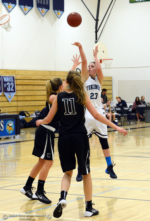 . Pleasant Valley High\'s #23 McKena Barker (right) takes a shot against Colfax High in the second quarter of their girls basketball game at PV\'s Varley Gym Saturday, December 7, 2013 in Chico, Calif. (Jason Halley/Chico Enterprise-Record)