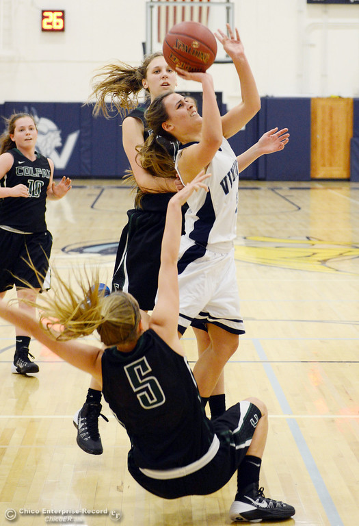 Description of . Pleasant Valley High's #3 Izzy Bonacorsi (center) drives to the basket against Colfax High's #5 Raegan Lillie (bottom) and #11 Kylee Bauer (back) in the first quarter of their girls basketball game at PV's Varley Gym Saturday, December 7, 2013 in Chico, Calif. (Jason Halley/Chico Enterprise-Record)