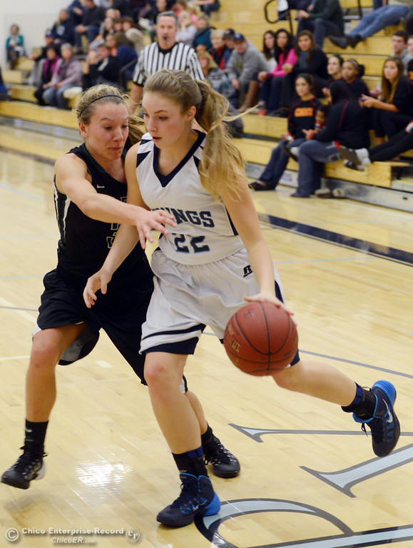 Description of . Pleasant Valley High's #22 Ashley Geiger (right) dribbles against Colfax High's #3 Kyra Heimann (left) in the second quarter of their girls basketball game at PV's Varley Gym Saturday, December 7, 2013 in Chico, Calif. (Jason Halley/Chico Enterprise-Record)
