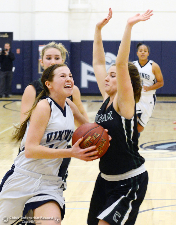 Description of . Pleasant Valley High's #11 Kristina Joyce (left) drives to the basket against Colfax High's #13 Kylie Kirkland (right) in the first quarter of their girls basketball game at PV's Varley Gym Saturday, December 7, 2013 in Chico, Calif. (Jason Halley/Chico Enterprise-Record)