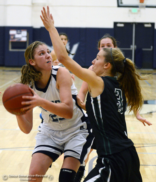 . Pleasant Valley High\'s #23 McKena Barker (left) goes up for a shot against Colfax High\'s #3 Kyra Heimann (right) in the second quarter of their girls basketball game at PV\'s Varley Gym Saturday, December 7, 2013 in Chico, Calif. (Jason Halley/Chico Enterprise-Record)