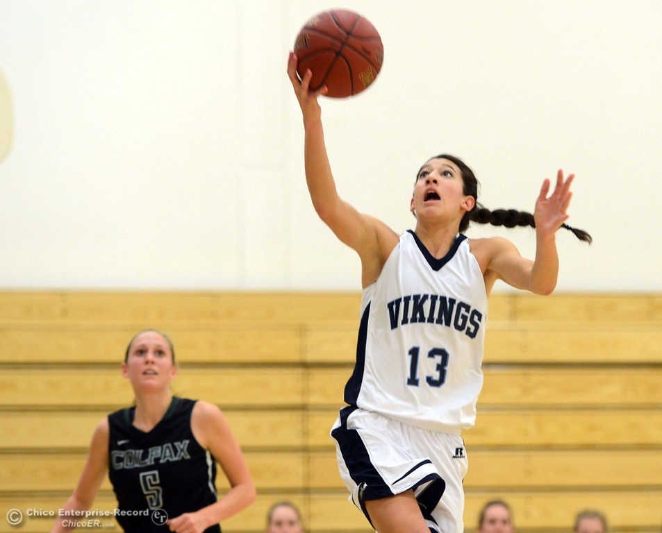 Description of . Pleasant Valley High's #13 Brianna Souza (right) goes up for a layup against Colfax High's #5 Raegan Lillie (left) in the second quarter of their girls basketball game at PV's Varley Gym Saturday, December 7, 2013 in Chico, Calif. (Jason Halley/Chico Enterprise-Record)