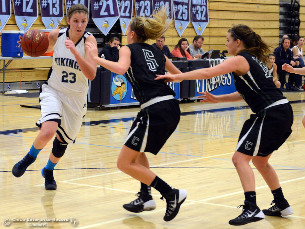 Description of . Pleasant Valley High's #23 McKena Barker (left) dribbles against Colfax High's #5 Raegan Lillie (center) and #13 Kylie Kirkland (right) in the first quarter of their girls basketball game at PV's Varley Gym Saturday, December 7, 2013 in Chico, Calif. (Jason Halley/Chico Enterprise-Record)
