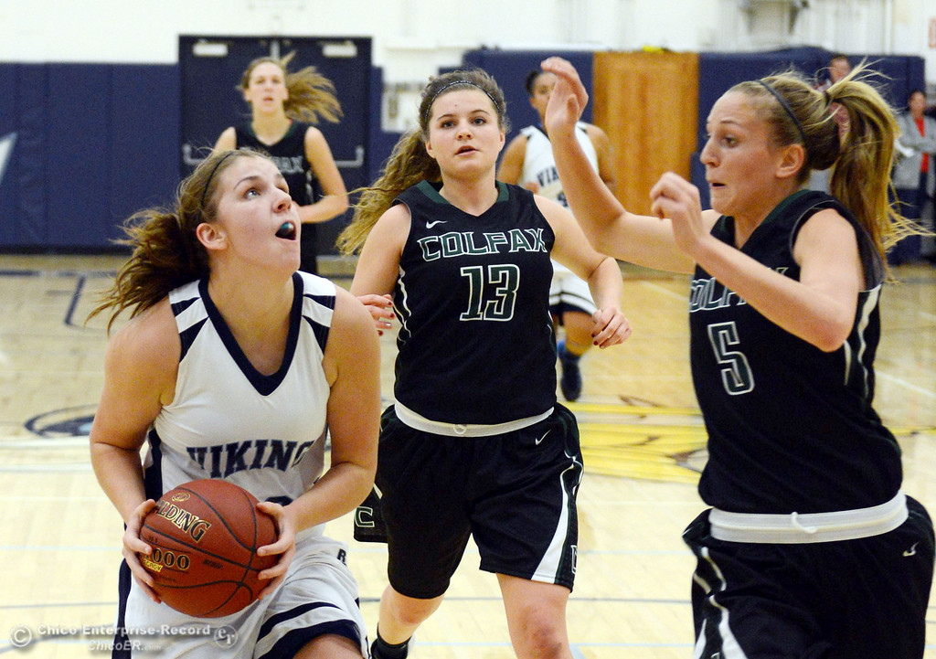 Description of . Pleasant Valley High's #23 McKena Barker (left) goes up for a shot against Colfax High's #13 Kylie Kirkland (center) and #5 Raegan Lillie (right) in the first quarter of their girls basketball game at PV's Varley Gym Saturday, December 7, 2013 in Chico, Calif. (Jason Halley/Chico Enterprise-Record)