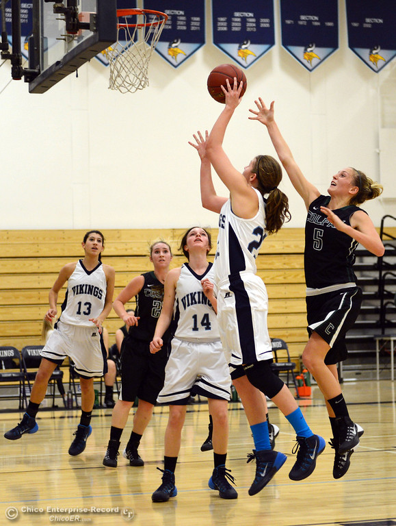 Description of . Pleasant Valley High's #23 McKena Barker (left) goes up for a shot against Colfax High's #5 Raegan Lillie (right) in the second quarter of their girls basketball game at PV's Varley Gym Saturday, December 7, 2013 in Chico, Calif. (Jason Halley/Chico Enterprise-Record)