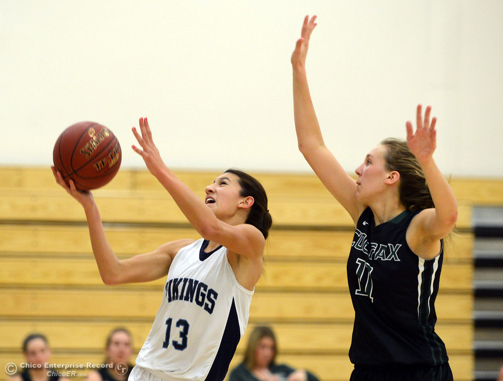 Description of . Pleasant Valley High's #13 Brianna Souza (left) goes up for a shot against Colfax High's #11 Kylee Bauer (right) in the second quarter of their girls basketball game at PV's Varley Gym Saturday, December 7, 2013 in Chico, Calif. (Jason Halley/Chico Enterprise-Record)
