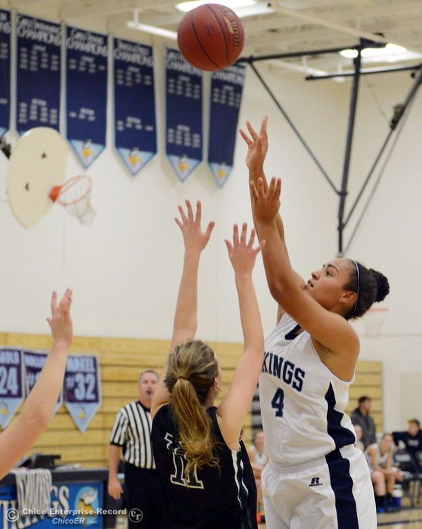 Description of . Pleasant Valley High's #4 Dominique Jackson (right) takes a shot against Colfax High's #11 Kylee Bauer (left) in the second quarter of their girls basketball game at PV's Varley Gym Saturday, December 7, 2013 in Chico, Calif. (Jason Halley/Chico Enterprise-Record)