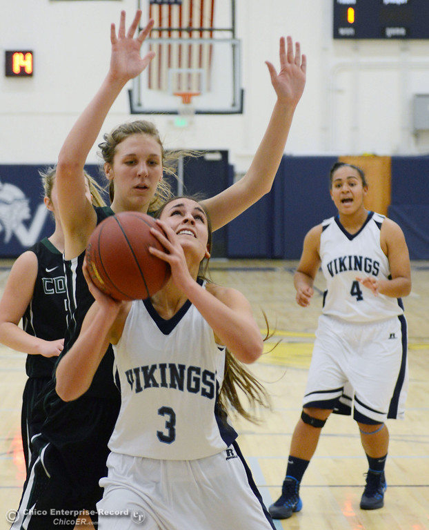 Description of . Pleasant Valley High's #3 Izzy Bonacorsi (front) goes up for a shot against Colfax High's #11 Kylee Bauer (back) in the first quarter of their girls basketball game at PV's Varley Gym Saturday, December 7, 2013 in Chico, Calif. (Jason Halley/Chico Enterprise-Record)