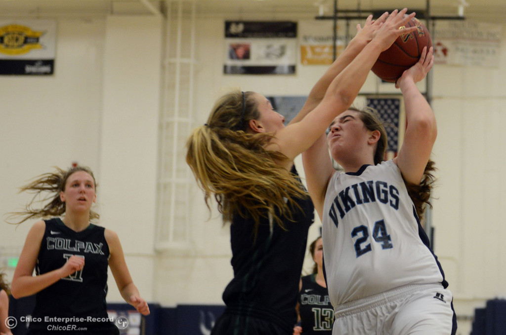 Description of . Pleasant Valley High's #24 Christa Feingold (right) goes up for a shot against Colfax High's #3 Kyra Heimann (left) in the second quarter of their girls basketball game at PV's Varley Gym Saturday, December 7, 2013 in Chico, Calif. (Jason Halley/Chico Enterprise-Record)