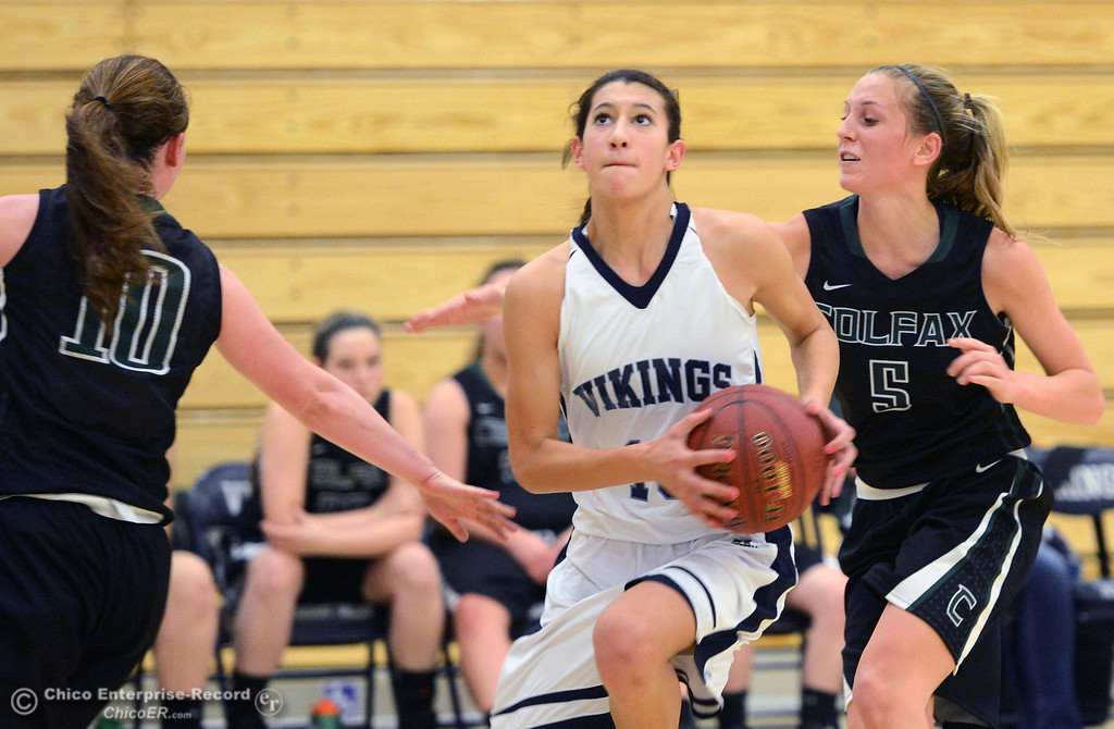 . Pleasant Valley High\'s #13 Brianna Souza (center) dribbles against Colfax High\'s #10 Taylor Avila (left) and #5 Raegan Lillie (right) in the second quarter of their girls basketball game at PV\'s Varley Gym Saturday, December 7, 2013 in Chico, Calif. (Jason Halley/Chico Enterprise-Record)