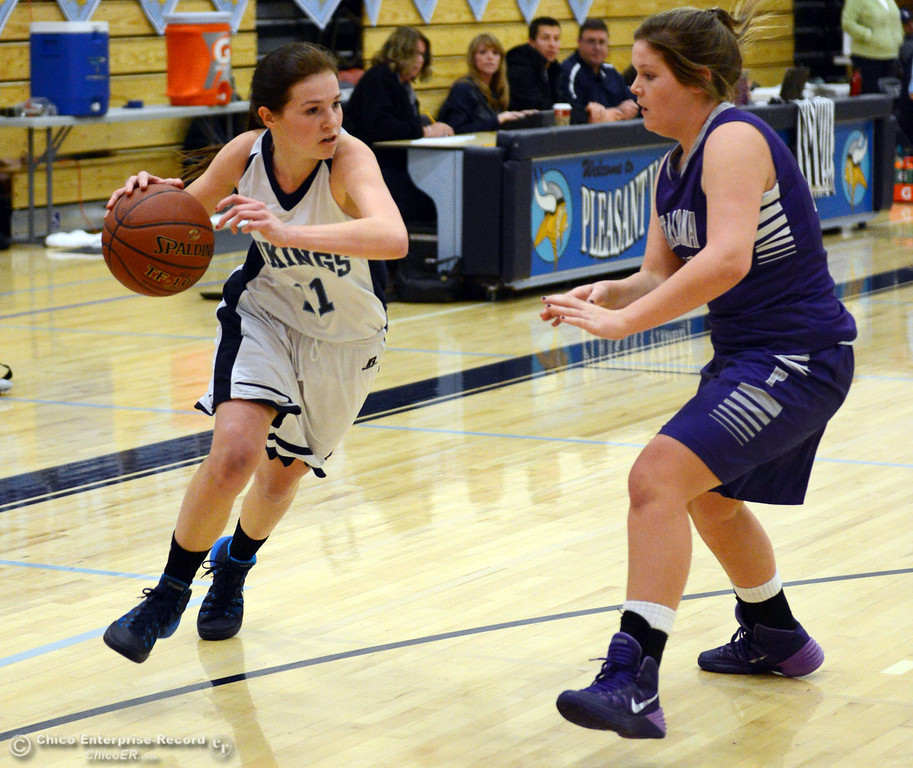 Description of . Pleasant Valley High's #11 Kristina Joyce (left) dribbles against Petaluma High's #21 Cassie Baddeley (right) in the first quarter of their girls basketball game at PVHS Varley Gym Friday, December 6, 2013 in Chico, Calif. (Jason Halley/Chico Enterprise-Record)