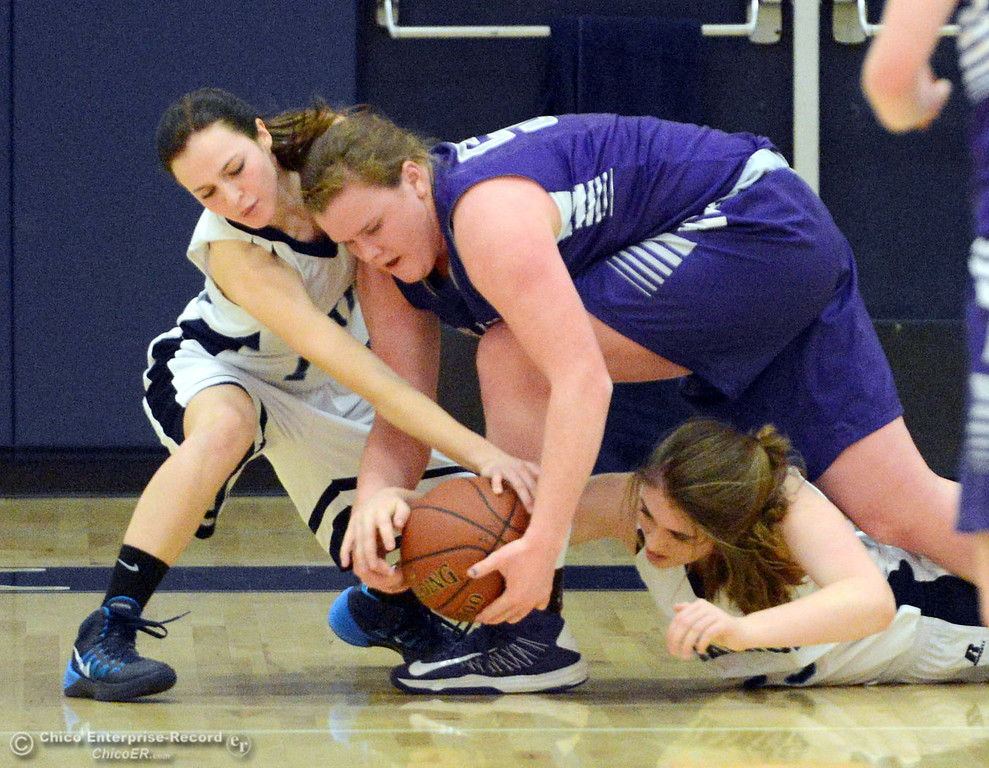 Description of . Pleasant Valley High's #14 Kayla Joyce (left) and #25 Courtney Holloway (right) battle for a loose ball against Petaluma High's #50 Allison Scranton (center) in the first quarter of their girls basketball game at PVHS Varley Gym Friday, December 6, 2013 in Chico, Calif. (Jason Halley/Chico Enterprise-Record)