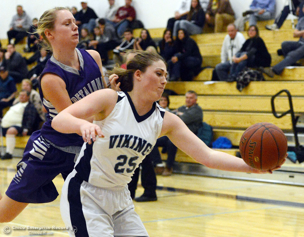 Description of . Pleasant Valley High's #25 Courtney Holloway (right) rebounds against Petaluma High in the first quarter of their girls basketball game at PVHS Varley Gym Friday, December 6, 2013 in Chico, Calif. (Jason Halley/Chico Enterprise-Record)