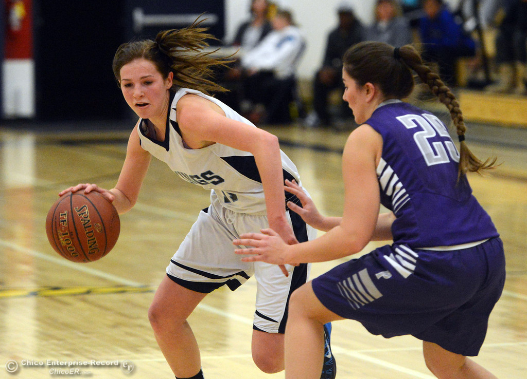 Description of . Pleasant Valley High's #11 Kristina Joyce (left) dribbles against Petaluma High's #25 Sophia Bihn (right) in the first quarter of their girls basketball game at PVHS Varley Gym Friday, December 6, 2013 in Chico, Calif. (Jason Halley/Chico Enterprise-Record)