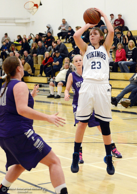 Description of . Pleasant Valley High's #23 McKena Barker (right) takes a shot against Petaluma High in the first quarter of their girls basketball game at PVHS Varley Gym Friday, December 6, 2013 in Chico, Calif. (Jason Halley/Chico Enterprise-Record)