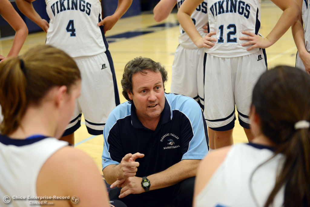 Description of . Pleasant Valley High head coach Tony Carlisle talks to the team against Petaluma High in the first quarter of their girls basketball game at PVHS Varley Gym Friday, December 6, 2013 in Chico, Calif. (Jason Halley/Chico Enterprise-Record)