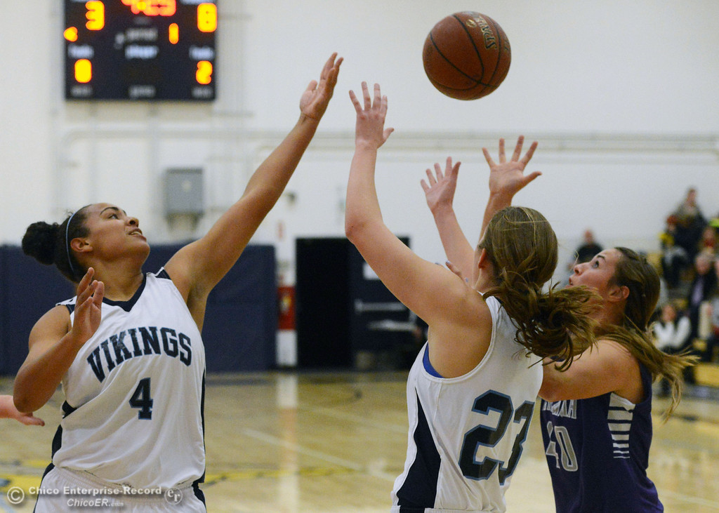 Description of . Pleasant Valley High's #4 Dominique Jackson (left) and #23 McKena Barker (center) attempt a rebound Petaluma High's #40 Joelle Krist (right) in the first quarter of their girls basketball game at PVHS Varley Gym Friday, December 6, 2013 in Chico, Calif. (Jason Halley/Chico Enterprise-Record)