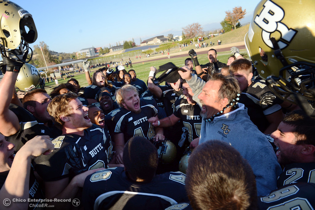 . Butte College head coach Jeff Jordan and the team celebrate their win against City College of San Francisco at the end of their football game at Butte\'s Cowan Stadium Saturday, November 16, 2013 in Butte Valley, Calif.  (Jason Halley/Chico Enterprise-Record)