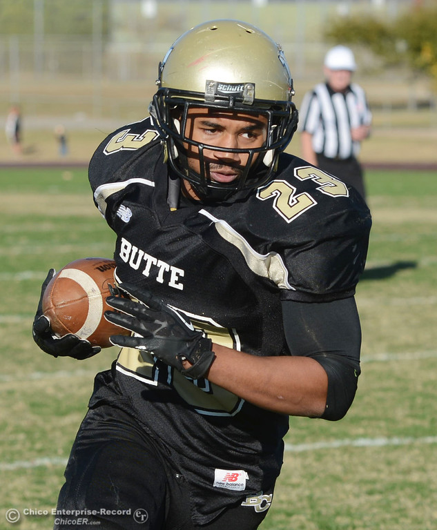 . Butte College\'s #23 Mykah Hester rushes against City College of San Francisco in the third quarter of their football game at Butte\'s Cowan Stadium Saturday, November 16, 2013 in Butte Valley, Calif.  (Jason Halley/Chico Enterprise-Record)