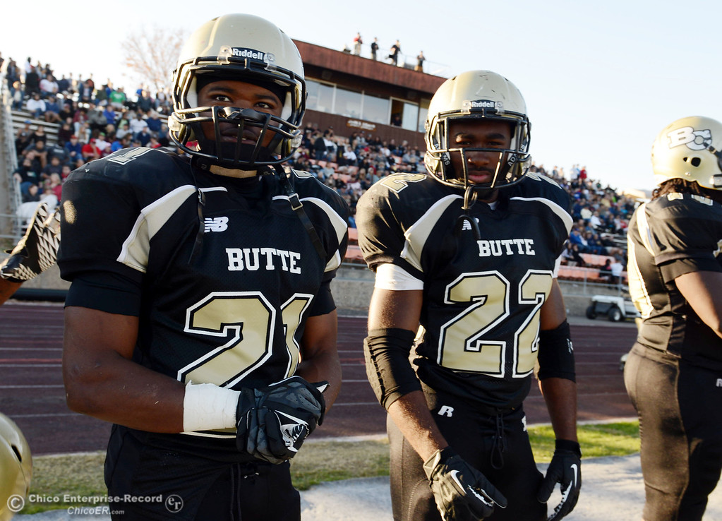 . Butte College\'s #21 Marvel Harris (left) and #22 Quinta Thomas (rihgt) look on against City College of San Francisco in the fourth quarter of their football game at Butte\'s Cowan Stadium Saturday, November 16, 2013 in Butte Valley, Calif.  (Jason Halley/Chico Enterprise-Record)
