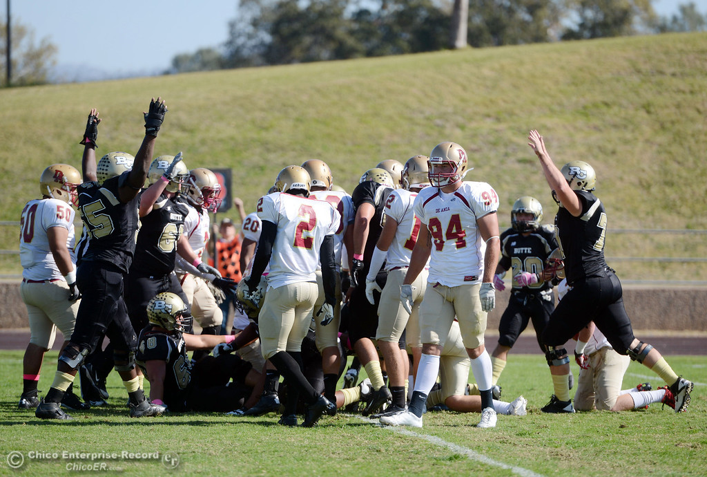 Description of . Butte College reacts to a touchdown against De Anza College in the first quarter of their football game at Butte\'s Cowan Stadium Saturday, October 26, 2013 in Oroville, Calif.  (Jason Halley/Chico Enterprise-Record)