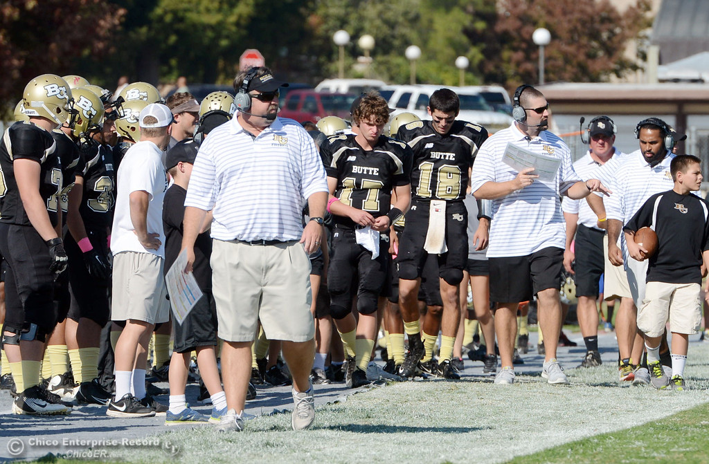 Description of . Butte College\'s coach Jeff Jordan (left) looks on against De Anza College in the second quarter of their football game at Butte\'s Cowan Stadium Saturday, October 26, 2013 in Oroville, Calif.  (Jason Halley/Chico Enterprise-Record)